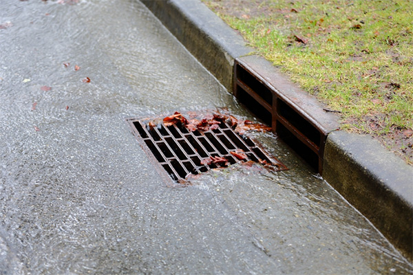Man forced to clear drain in front of house