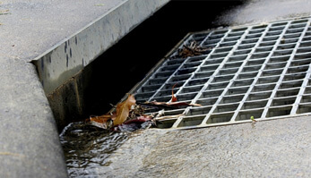 Storm drain cleaning is essential to prevent street flooding